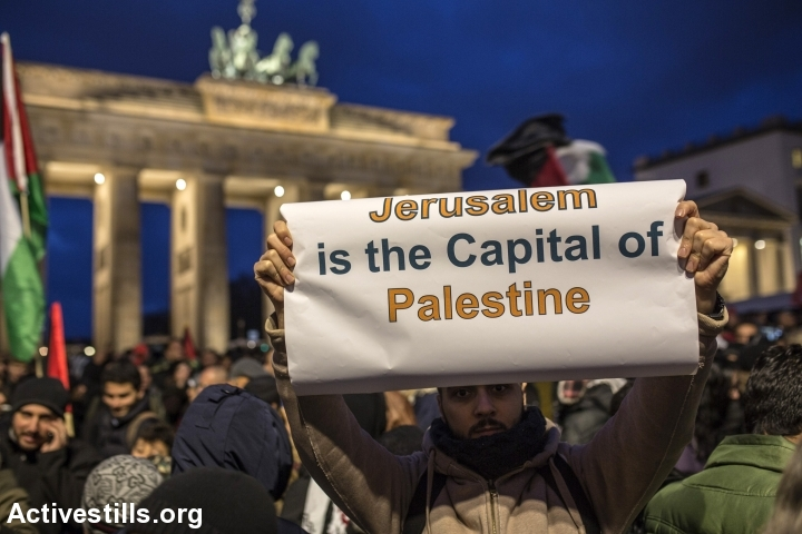 A demonstrator shows a banner during a protest in front of the US Embassy against the US President Trump's decision to recognise Jerusalem as the new capital of Israel, Berlin, Germany, December 8, 2017. (Anne Paq/Activestills.org)