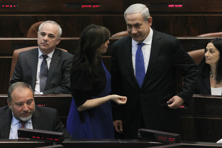 Israel's Prime Minister Benjamin Netanyahu seen speaking with fellow Likud parliament member Tzipi Hotovely during a plenum session in the Israeli parliament on October 15, 2012. (Miriam Alster/Flash90)