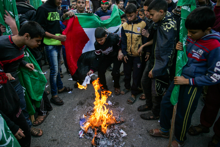 Palestinians burn a photo of U.S. President Donald Trump during a protest against the decision to recognize Jerusalem as the capital of Israel, Rafah, Gaza Strip, December 8, 2017. (Abed Rahim Khatib/Flash90)