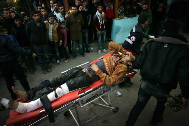 A wounded Palestinian is carried on a stretcher during clashes with Israeli security forces on the Israeli-Gaza border, Khan Yunis, Gaza Strip, December 8, 2017. (Abed Rahim Khatib/Flash90)