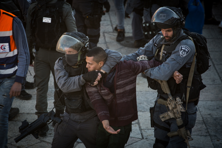 Israeli Police arrest a Palestinian protester at Damascus Gate in the Old City of Jerusalem, following U.S. President Donald Trump's announcement to recognize Jerusalem as the capital of Israel, December 8, 2017. (Hadas Parush/Flash90)