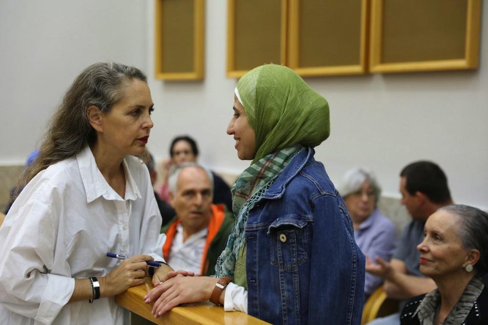 Palestinian poet Dareen Tatour (r) and Attorney Gaby Lasky seen in the Nazareth court. (Oren Ziv/Activestills.org)