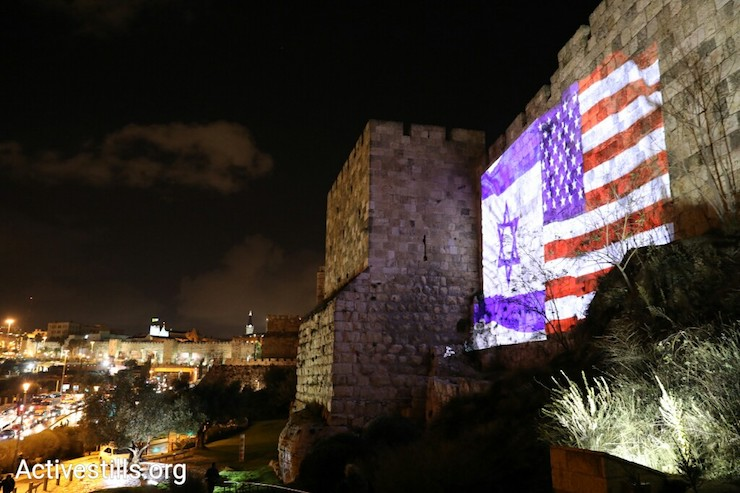 The Jerusalem Municipality lights up the Old City's walls with the American and Israeli flags ahead of Donald Trump's recognition of the city as Israel's capital, December 6, 2017. (Oren Ziv/Activestills.org)