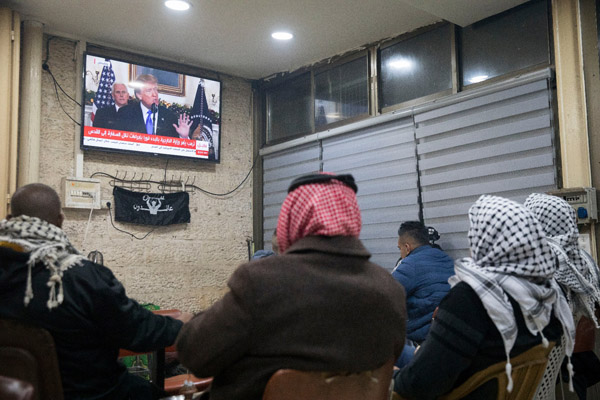 Palestinians in an East Jerusalem cafe watch Donald Trump's declaration recognizing the city as Israel's capital, December 6, 2017. (Oren Ziv/Activestills.org)
