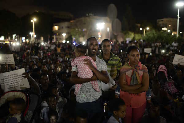 """African asylum seekers protest on Saturday against the """"Deposit Law"""", requires which Eritreans and Sudanese to deposit fifth percent of their salary in government supervised accounts. (Tomer Neuberg/Flash90)"""