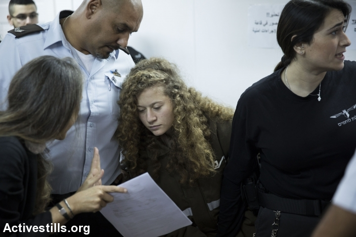 Israeli lawyer Gaby Lasky (L) speaks with her client, sixteen-years-old Ahed Tamimi (R), before she stands for a hearing at the military court in Ofer military prison, near the West Bank city of Ramallah, January 15, 2018. (Oren Ziv/Activestills.org)