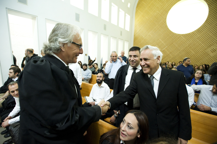 Former President Moshe Katsav speaks with his attorney, Zion Amir, in the Israel's Supreme Court in Jerusalem. Katsav was convicted of rape and sentenced to seven years in prison. November 10, 2011. (Omer Miron/Flash90)