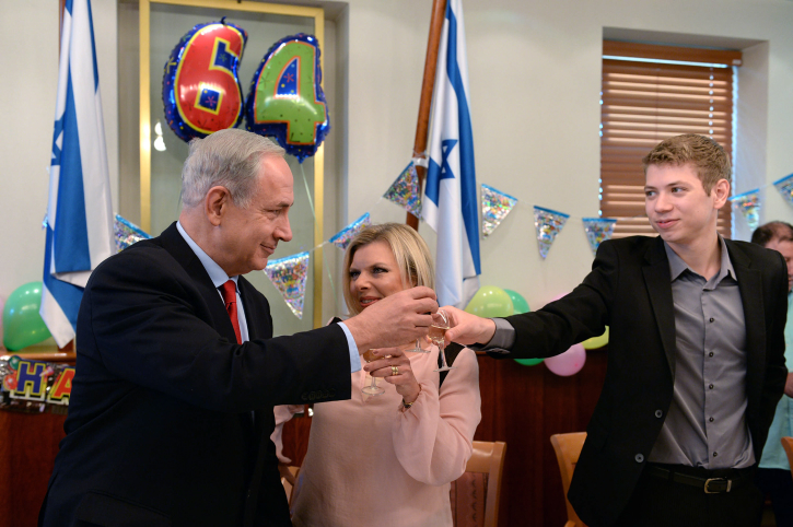 Israeli Prime Minister Benjamin Netanyahu seen with his wife Sara and their son Yair, celebrating the Prime Minister's 64th birthday, October 20, 2013. (Kobi Gideon/GPO