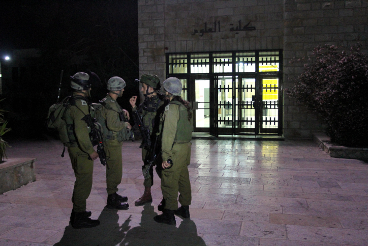 Israeli soldiers patrol at Birzeit University, on the outskirts of the city of Ramallah in the West Bank, during an operation on June 19, 2014. (Issam Rimawi/Flash90) *** Local Caption *** ?????? ??????? ????? ??????