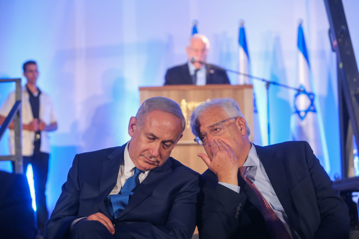 Israeli Prime minister Benjamin Netanyahu speaks with U.S. Ambassador to Israel David Friedman during a ceremony marking the 50th anniversary of Israel capturing East Jerusalem, May 21, 2017. (Alex Kolomoisky/Flash90)