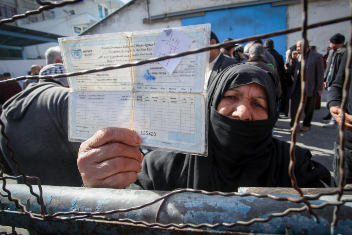 Palestinians take part in a protest outside a United Nations (UN) distribution centre in Rafah in the southern Gaza Strip, on January 21, 2018, following the decision by the US government to froze tens of millions of dollars in contributions to UNRWA. (Rahim Khatib/Flash90)