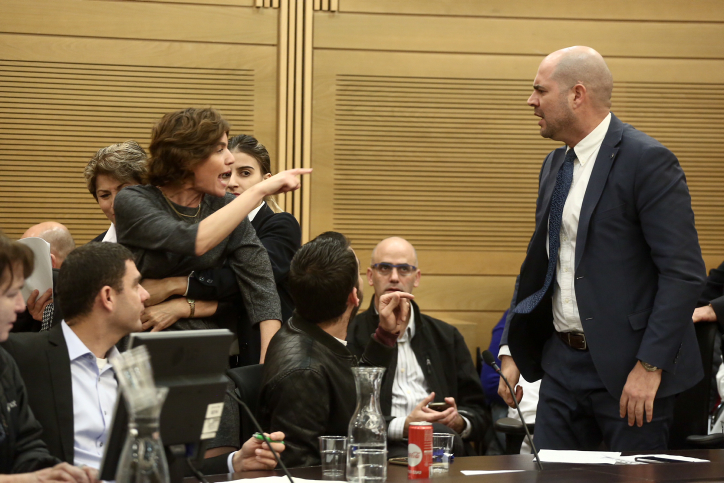 Meretz MK Tamar Zandberg argues with Likud MK Amir Ohana during a Knesset Interior Affairs Committee meeting regarding the deportation of African asylum seekers, January 29, 2018. (Miriam Alster/Flash90)