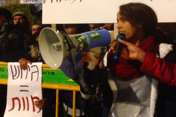 A female asylum seeker speaking at the protest outside Rivlin's residence on January 22, 2018 (Joshua Leifer)