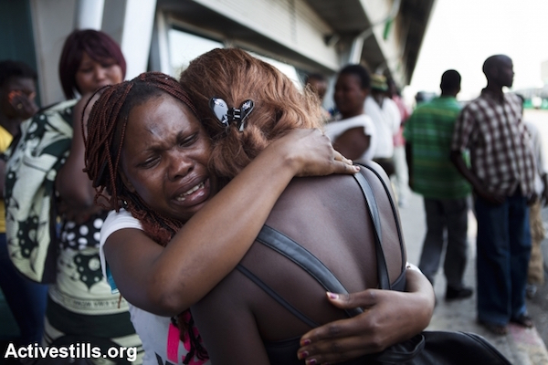 Two women embrace before the deportation of South Sudanese refugees in 2012. (Oren Ziv/Activestills.org)