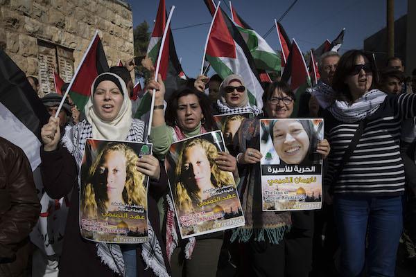 Demonstrators, including former member of the European Parliament Luisa Morgentini, lead the march in Nabi Saleh. January 13, 2018. (Oren Ziv/Activstills.org)