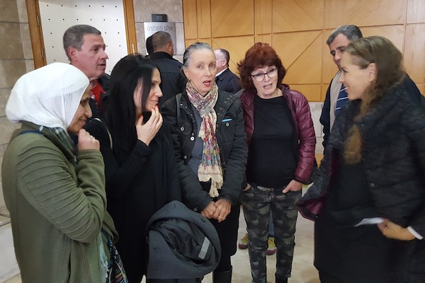 Palestinian poet Dareen Tatour (left) and her supporters speak to Attorney Gaby Lasky inside the Nazareth court, February 18, 2018. (Yoav Haifawi)
