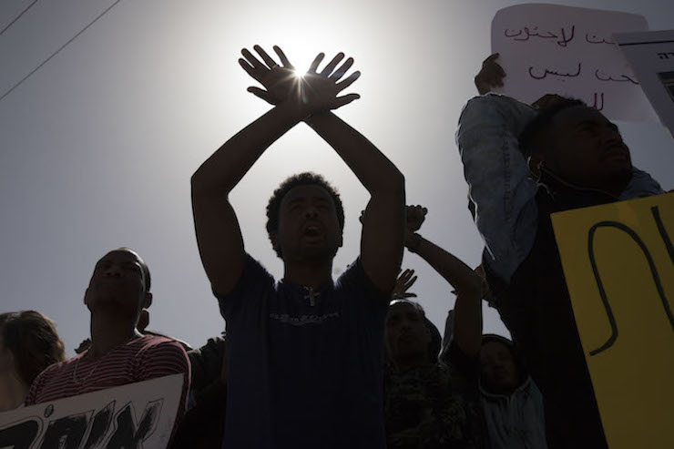 Eritrean and Sudanese asylum seekers protest Israel's deportation plan, following the indefinite detention of seven asylum seekers who refused to leave Israel for a third country in Africa. February 22, 2018. (Oren Ziv/Activestills.org)