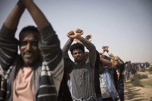 Asylum seekers protest outside Holot detention center against Israel's deportation plan. February 22, 2018. (Oren Ziv/Activestills)