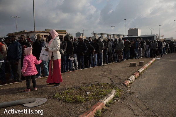 Eritrean and Sudanese asylum seekers line up hoping to file asylum claims, renew visas at Israeli Interior Ministry in Bnei Brak. February 18, 2018. (Oren Ziv/Activestills.org)