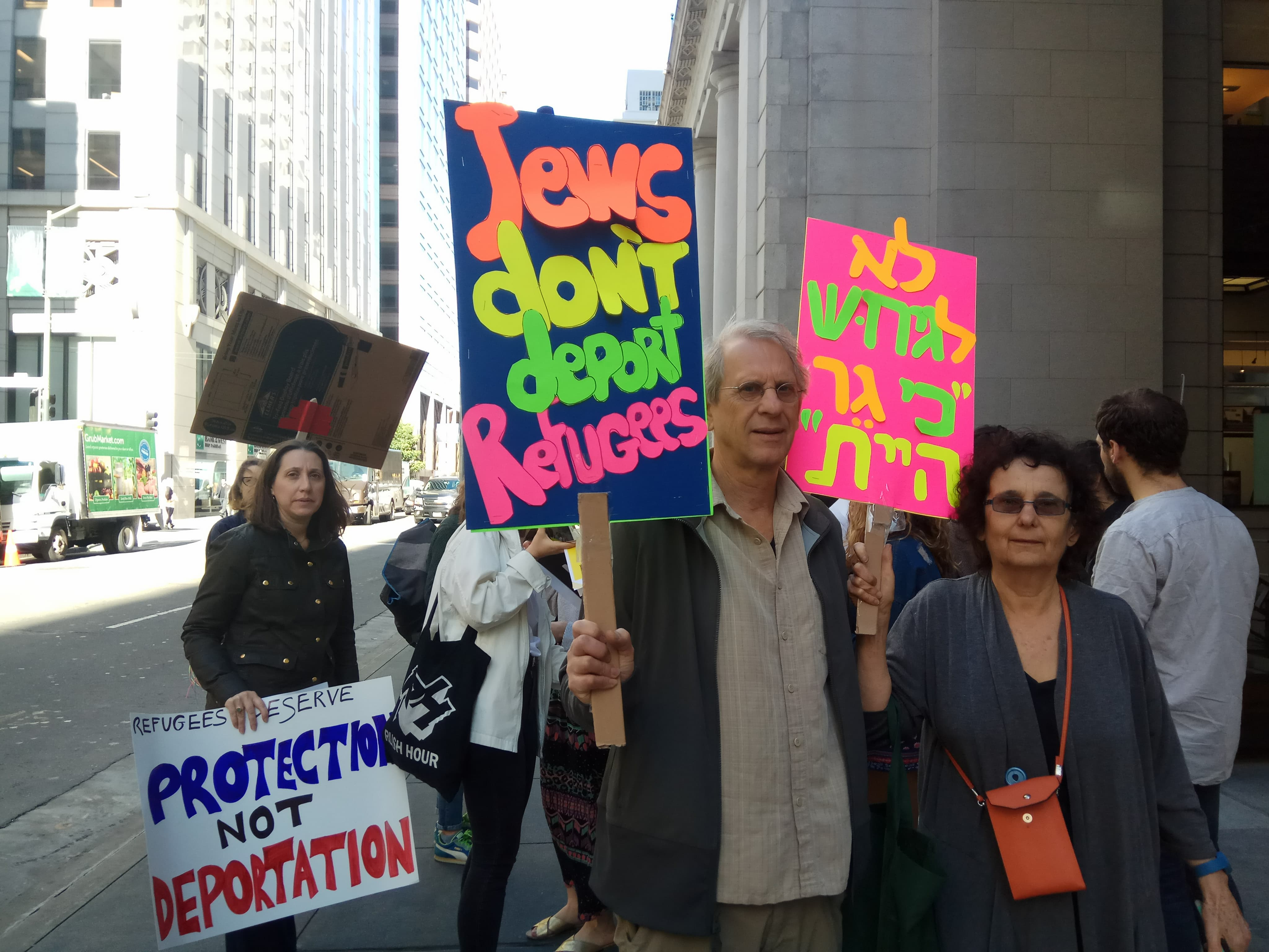 Protesters hold signs against the deportation of African refugees outside the Israeli consulate in San Francisco, February 7, 2018. (Rob Ungar)