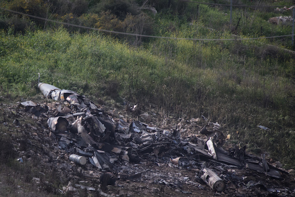 Remains of an F-16 plane crashed on Saturday morning near the Israeli town of Harduf in northern Israel, on February 10, 2018. (Hadas Parush/Flash90)
