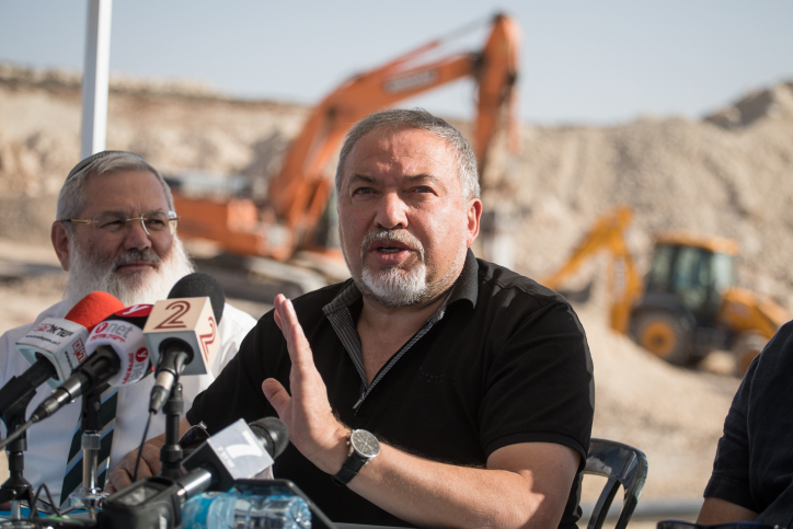 Israeli minister of Defense Avigdor Liberman holds a press conference during the construction of the new Israeli settlement Amichai, to be established as the new home for the evacuated residents of Amona, October 18, 2017. (Hadas Parush/Flash90)