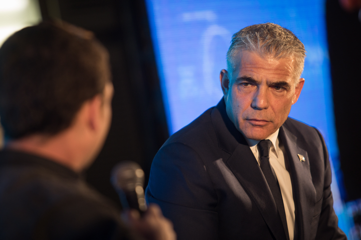 Head of the Yesh Atid party Yair Lapid speaks at the 15th annual Jerusalem Conference of the 'Besheva' group, on February 12, 2018. (Hadas Parush/Flash90)