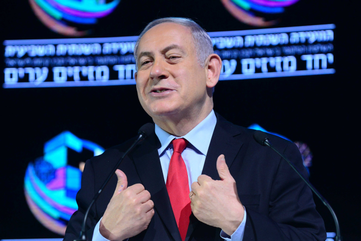 Prime Minister Benjamin Netanyahu speaks at the Muni Expo 2018 conference at the Tel Aviv Convention Center, February 14, 2018. (Tomer Neuberg/Flash90)