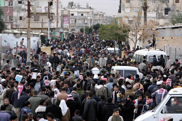 Hundreds of thousands of Palestinian civilians cross from Gaza into Egypt after Palestinian militants bulldozed a section of the border wall, temporarily breaking the siege, January 23, 2008. (Rahim Khatib /Flash90)