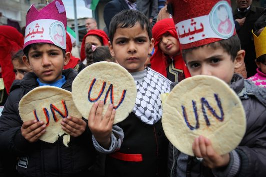 Palestinians take part in a protest against aid cuts, outside the United Nations' offices in Khan Younis in the southern Gaza Strip, January 28, 2018. (Abed Rahim Khatib/ Flash90)