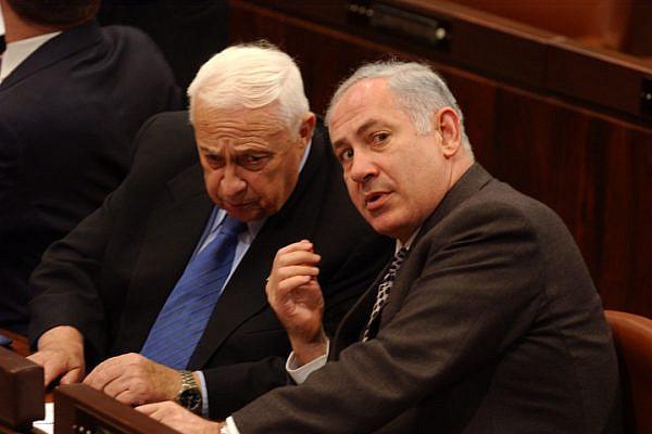 Former Israeli Prime Minister Ariel Sharon speeks with Benjamin Netanyahu (L) during a Knesset session. (Flash90)