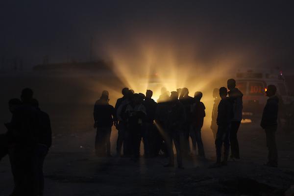 Palestinians gather near an ambulance after a protest near the border fence east of Gaza City, Gaza Strip, December 22, 2017. (Wissam Nassar/Flash90)