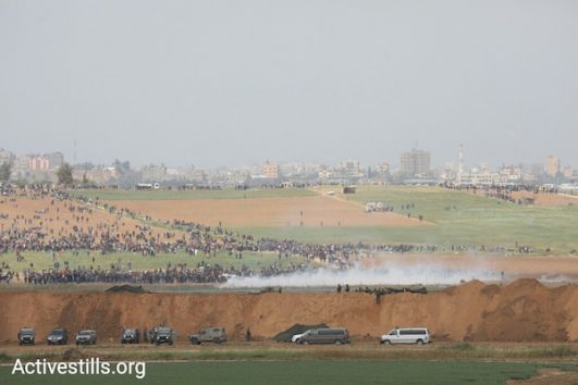 Israeli forces fire tear gas at Palestinian demonstrators in Gaza during the beginning of the 'Great Return March.' March 30, 2018. (Oren Ziv/Activestills.org).