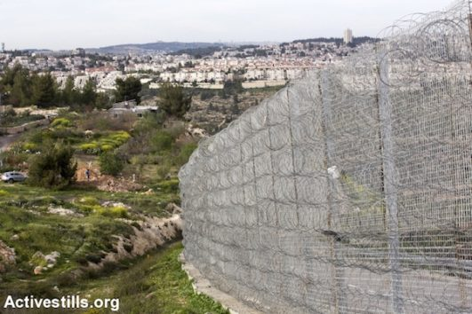 A new portion of the Separation Wall, made by a high barbed wire fence in the West Bank village of Walajeh, March 18, 2018. (Anne Paq/Activetills.org)