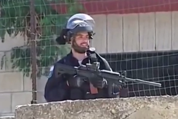 A screenshot, purportedly of Ben Deri, at the scene where he shot Nadeem Nawara in Beitunia on May 15, 2014. (See the full video below)