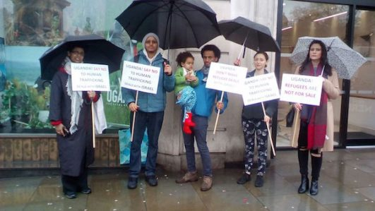 Activists brave the rain to protest outside the Ugandan embassy in London. April 9, 2018. (Courtesy of Maayan Niezna)