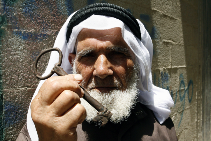 A Palestinian refugee, Saleh Saleh Abu Rass, holds up a key from his original home in Be'er Sheva, located in southern Israel, during a rally, in Rafah refugee camp, southern Gaza Strip, May 12, 2013. (Abed Rahim Khatib/Flash 90)