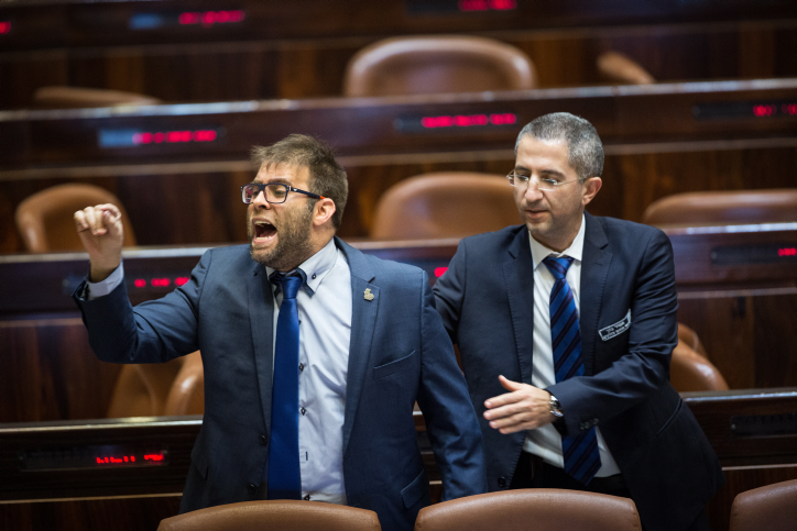 MK Oren Hazan is removed from the Knesset chambers during a speech by Palestinian MK Haneen Zoabi, December 27, 2017. (Hadas Parush/Flash90)