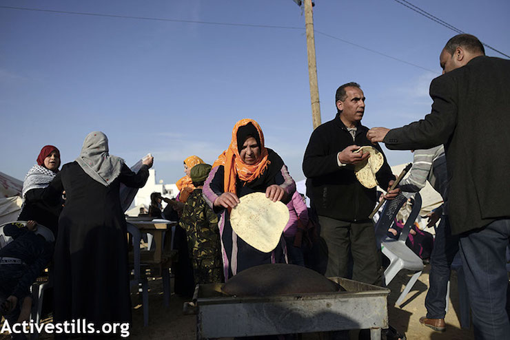 Um Yousef Lubbad makes a traditional dish from her home town of Al Majdal at the protest encampment east of Shajaiya in Gaza. (Mohammed Zaanoun / Activestills.org)
