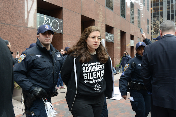 Police arrest an IfNotNow protester outside Senator Chuck Schumer's office in New York City, during an action protesting IDF violence on the border with Gaza, April 9, 2018. (Gili Getz)