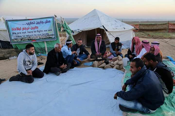 Palestinians sit in a tent encampment built to represent the various villages and towns that were destroyed during the Nakba in 1948.