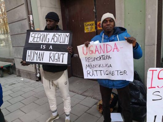Activists in Stockholm protest outside the Ugandan embassy against Israel's plan to deport Eritrean and Sudanese refugees there. April 9, 2018. (Courtesy of Netta Beer)