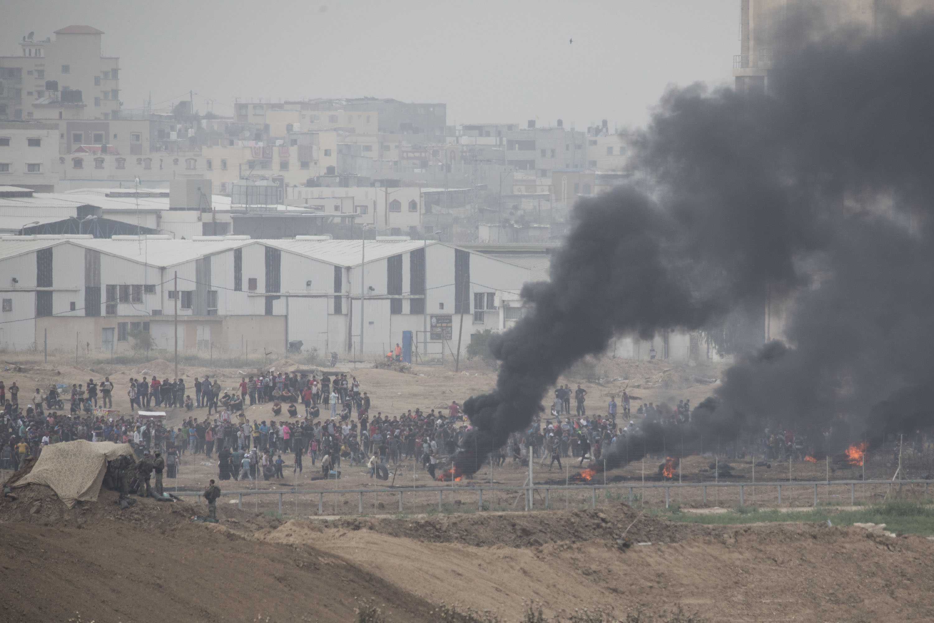 Smoke billows from the Gaza side of the Gaza-Israel border during the Great Return March demonstrations, May 4, 2018. (Oren Ziv/Activestills.org)