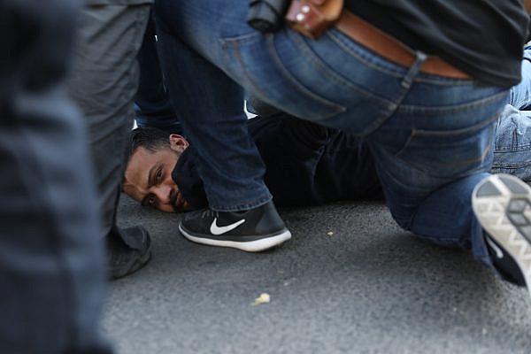 Israeli police arrest a Palestinian protester outside the new U.S. Embassy in Jerusalem. May 14, 2018. (Oren Ziv/Activestills.org)
