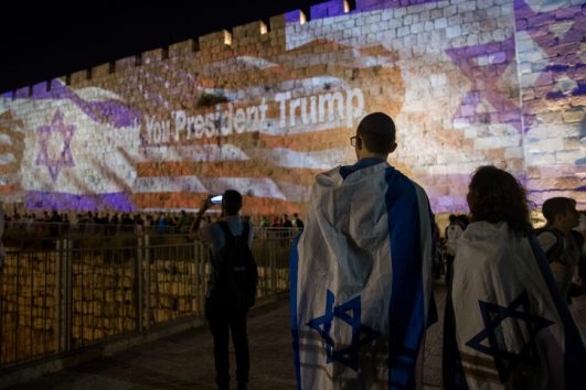 Israeli and the American flags are screened on the walls of Jerusalem's Old City, ahead of the opening of the U.S. Embassy in Jerusalem, May 13, 2018. (Yontan Sindel/Flash90(