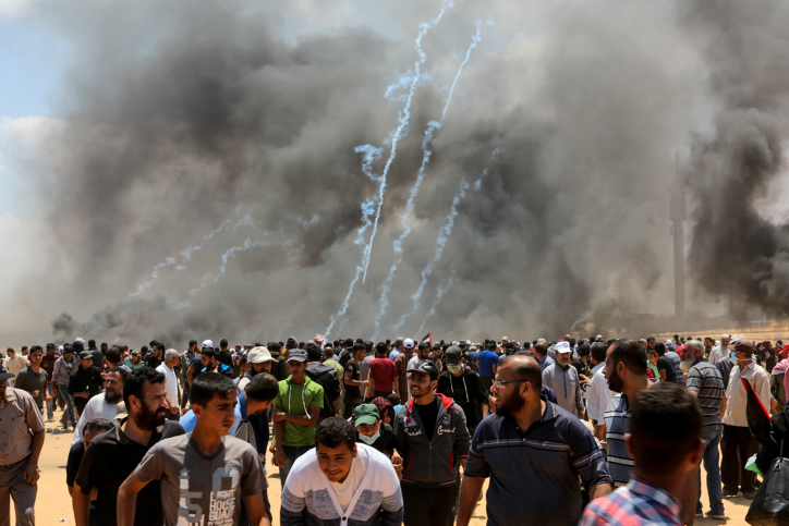 Palestinian protesters seen during clashes with Israeli forces near the Gaza-Israel border, Rafah, May 14, 2018. (Abed Rahim Khatib/Flash90)