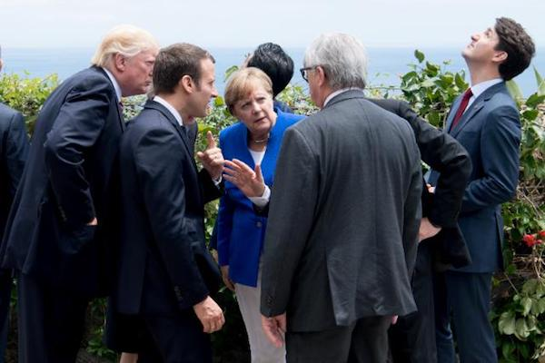 Donald Trump leans in to a discussion among leaders at the G7 Summit in Taormina, Italy, May 26, 2017. (EU Photo)