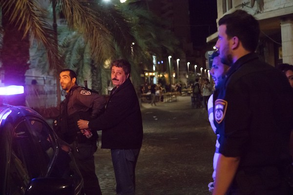 Jafar Farah is seen being arrested by Israeli police near the protest in Haifa, held to demonstrate against the mass killing of protesters in Gaza, May 19, 2018. (Nadine Nashef)