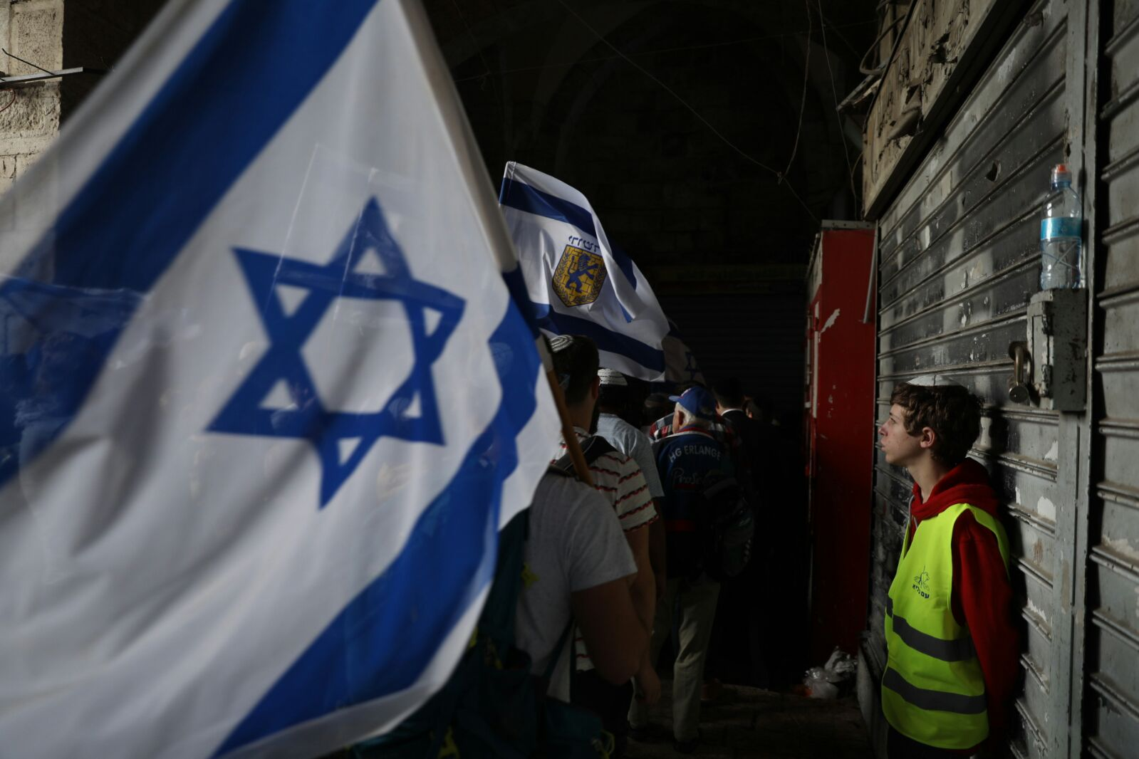Israeli nationalists march through the Muslim Quarter of Jerusalem's Old City during the 'March of the Flags,' part of the annual Jerusalem Day celebrations, May 13, 2018. (Oren Ziv/Activestills.org)
