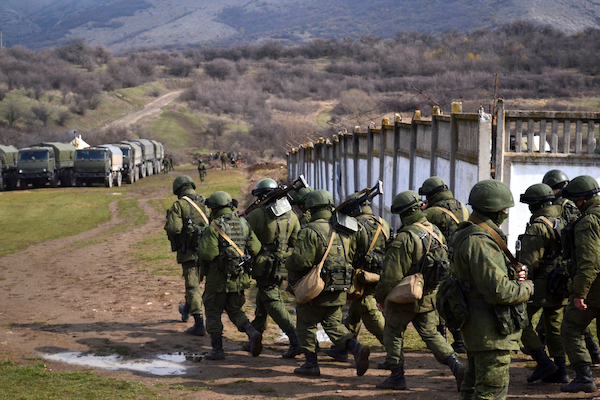 Unmarked Russian soldiers, known as 'Little Green Men,' after the seizure of Perevalne military base, Crimea, March 9, 2014. (Anton Holoborodko/CC BY-SA 3.0)